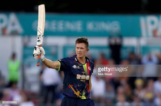 Joe Denly of Kent celebrates scoring a century of runs during the Essex v Kent NatWest T20 Blast cricket match at the Cloudfm County Ground on August...