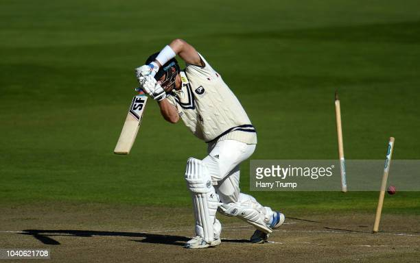 Joe Denly of Kent is bowled by Keith Barker of Warwickshire for 0 during Day Three of the Specsavers County Championship Division Two match between...