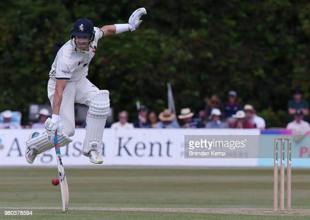 Joe Denly of Kent jumps to avoid the ball on day two of the Specsavers County Championship Division Two match between Kent and Warwickshire at The...