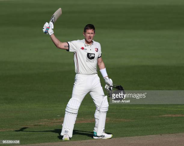 Joe Denly of Kent raises his bat after reaching a century on day 4 of the tour match between Kent and Pakistan on May 01 2018 in Canterbury England