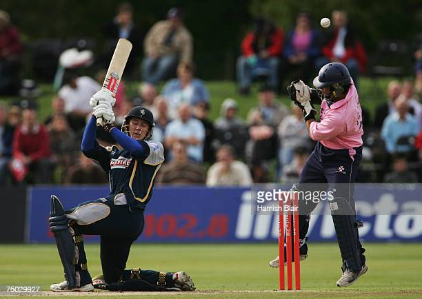 Joe Denly of Kent Spitfires hits the ball over wicket keeper Ben Scott Middlesex Crusaders during the The Twenty20 Cup match between Kent Spitfires...