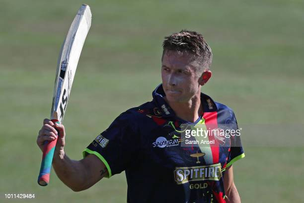 Joe Denly of Kent Spitfires raises his bat as he leaves the field unbeaten on 99 runs during the Vitality Blast match between Kent Spitfires and...