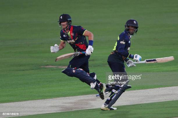 Joe Denly of Kent Spitfires runs a quick single with opening partner Daniel BellDrummond during the NatWest T20 Blast South Group match at The...