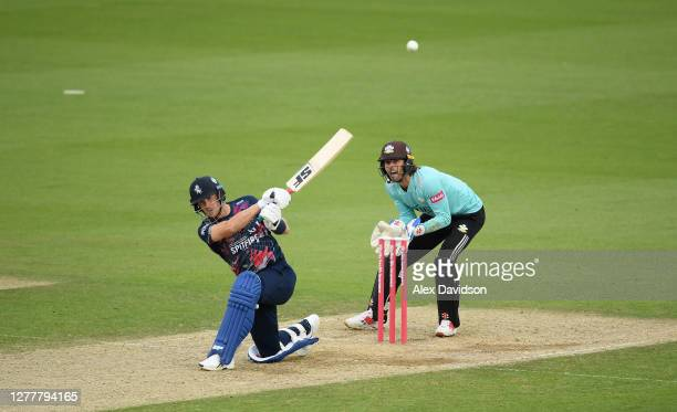 Joe Denly of Kents hits out watched on by Ben Foakes of Surrey during the Vitality Blast QuarterFinal match between Surrey and Kent Spitfires at The...