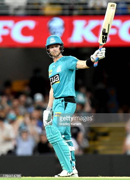 Joe Denly of the Heat celebrates after scoring his half century during the Big Bash League match between the Brisbane Heat and the Sydney Thunder at...