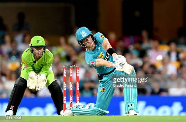 Joe Denly of the Heat hits the ball over the boundary for a six during the Big Bash League match between the Brisbane Heat and the Sydney Thunder at...