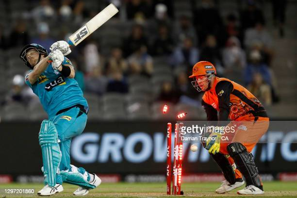 Joe Denly of the Heat is bowled by Fawad Ahmed of the Scorchers during the Big Bash League match between the Perth Scorchers and the Brisbane Heat at...