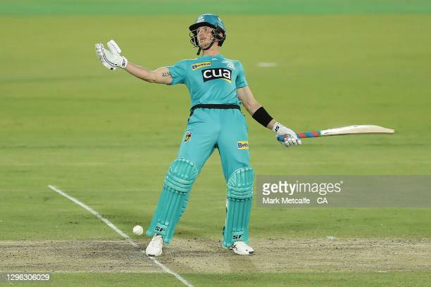Joe Denly of the Heat reacts to a delivery during the Big Bash League match between the Brisbane Heat and the Melbourne Renegades at Manuka Oval, on...
