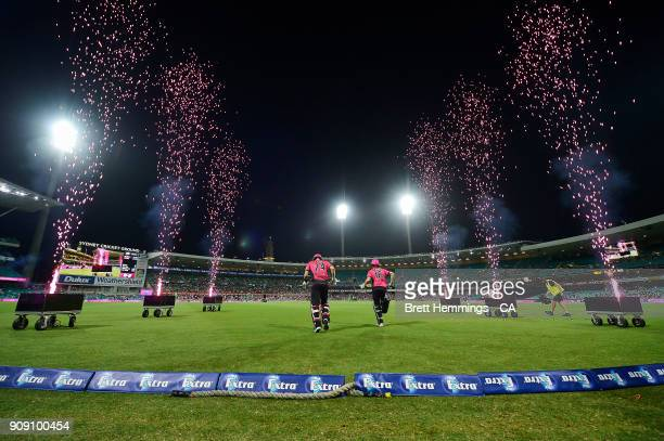 Joe Denly of the Sixers and Daniel Hughes of the Sixers take to the field during the Big Bash League match between the Sydney Sixers and the...