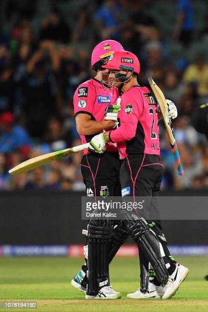 Joe Denly of the Sixers and Josh Philippe of the Sixers celebrate after defeating the Adelaide Strikers during the Big Bash League match between the...