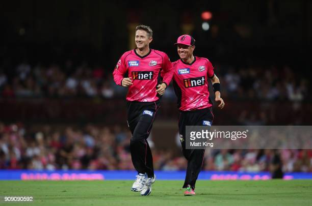 Joe Denly of the Sixers celebrates with Johan Botha after taking the wicket of Seb Gotch of the Stars during the Big Bash League match between the...