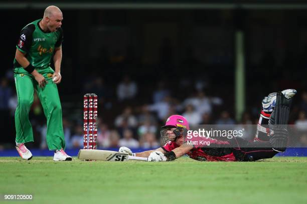 Joe Denly of the Sixers slides in to avoid a runout during the Big Bash League match between the Sydney Sixers and the Melbourne Stars at Sydney...