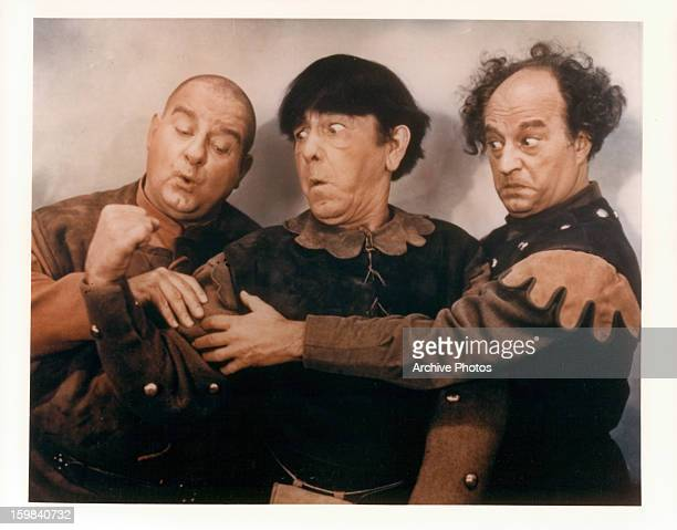 Joe DeRita Moe Howard and Larry Fine in a scene from the film 'Snow White And The Three Stooges' 1961