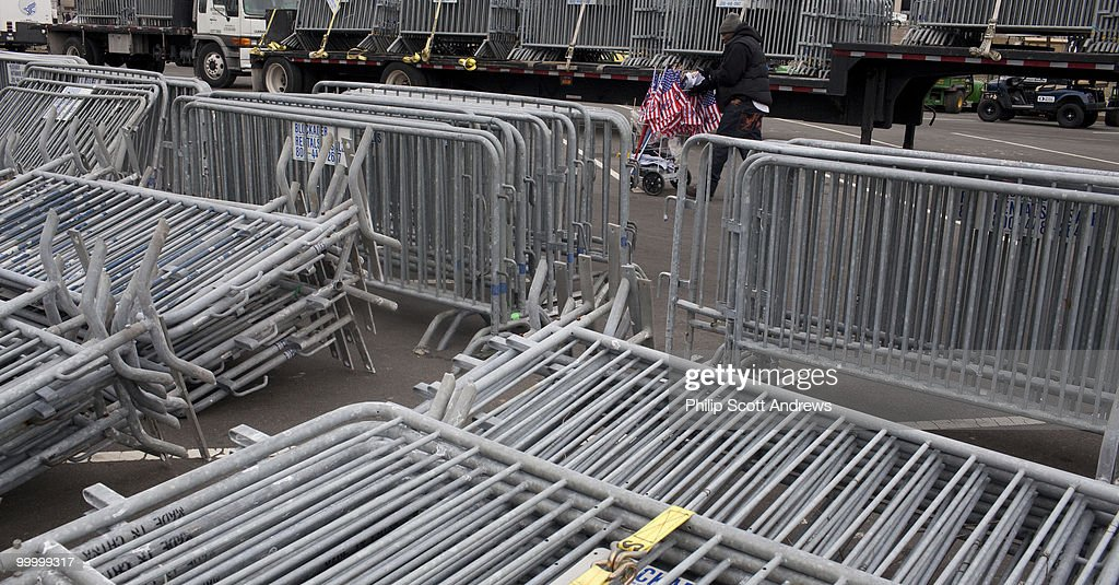 Joe Dick, of Providence RI., pushes a cart filled with flags along a side street filled with security barricades that was to be set up the day before the opening ceremony of the 56th Inauguration on in Washington, D.C. January 17, 2009.