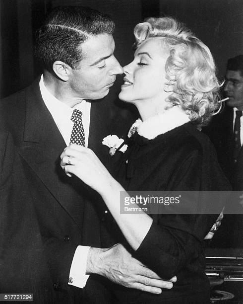 Joe DiMaggio and Marilyn Monroe kiss following their marriage ceremony in a judge's chambers in San Francisco, California.