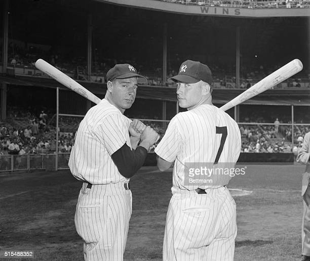 Joe DiMaggio and Mickey Mantle Holding Bats