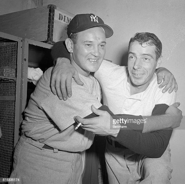 Joe DiMaggio and pitcher Allie Reynolds both of the Yankees embrace in the Yanks dressing room after they helped slug the Giants 62 in the fourth...