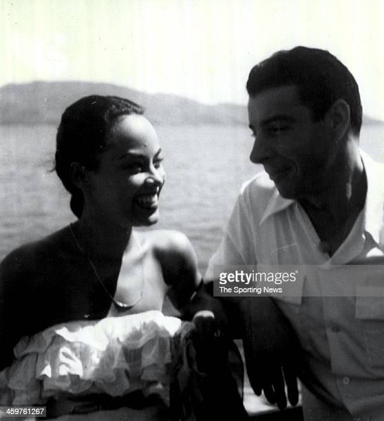Joe DiMaggio chats with Olga Chaviano Cuban Dancer star of Ciro's Night Club show at Hotel Reforma Casa Blanca in Acapulco