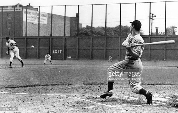 CLEVELAND JULY 16 1941 Joe DiMaggio drives a pitch up the middle to establish a new and still standing record hitting in 56 straight games in a game...