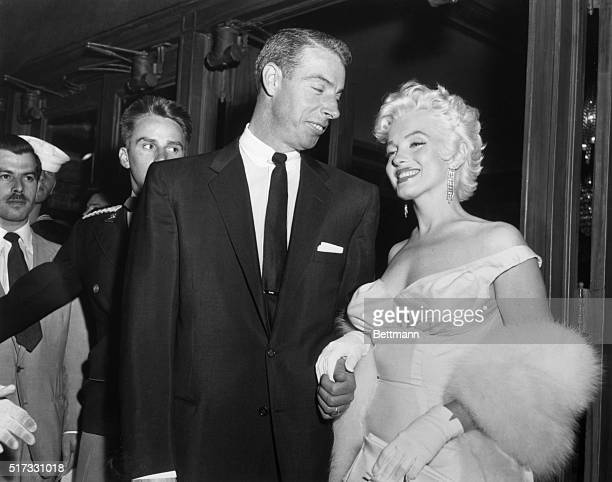 Joe DiMaggio escorts ex-wife Marilyn Monroe to the premiere of her movie The Seven Year Itch