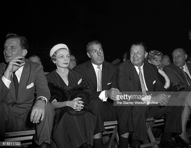 Joe DiMaggio is one of the many spectators at the Carmen Basilio vs Sugar Ray Robinson middleweight title fight in Bronx New York September 23 1957