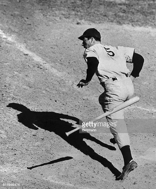 Joe DiMaggio looks surprised even if it seems to be getting a habit to hit regularly in baseball games these days. Joe is shown getting the hit in...