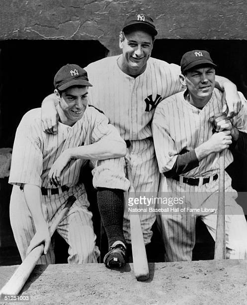 Joe DiMaggio Lou Gehrig#4 Billy Dickey#8 of the New York Yankees pose in the dugout before a season game Joe DiMaggio played for the New York Yankees...