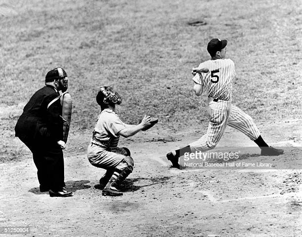 Joe DiMaggio makes a pop fly after the swing during a season game. Joe DiMaggio played for the New York Yankees from 1936-1951.
