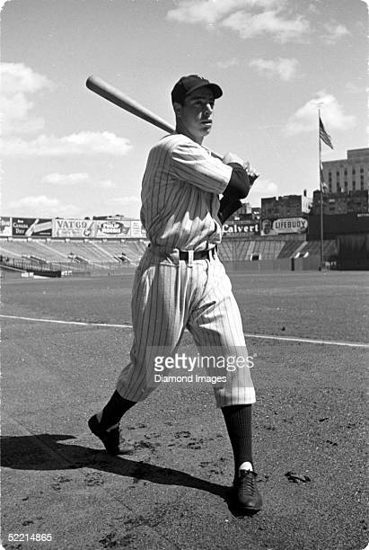 Joe DiMaggio of the New York Yankees poses for a portrait prior to a 1937 game at Yankee Stadium in the Bronx, New York.