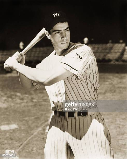 Joe DiMaggio of the New York Yankees poses for an action portrait before a season game Joe DiMaggio played for the New York Yankees from 19361951