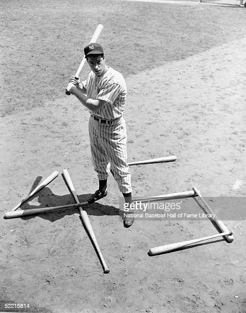 Joe DiMaggio of the New York Yankees stands with some bats that say 45 for the record for consecitive hits in Yankee Stadium at the Bronx New York on...