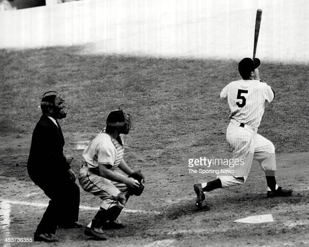 Joe DiMaggio of the New York Yankees strikes out during the 1951 World Series at Yankee Stadium in New York CIty DiMaggio played for the Yankees from...