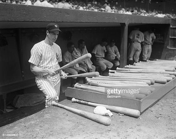 Joe DiMaggio of the Yanks neared the alltime record in the first game with Boston today when he scored a hit in the fifth inning This meant that he...