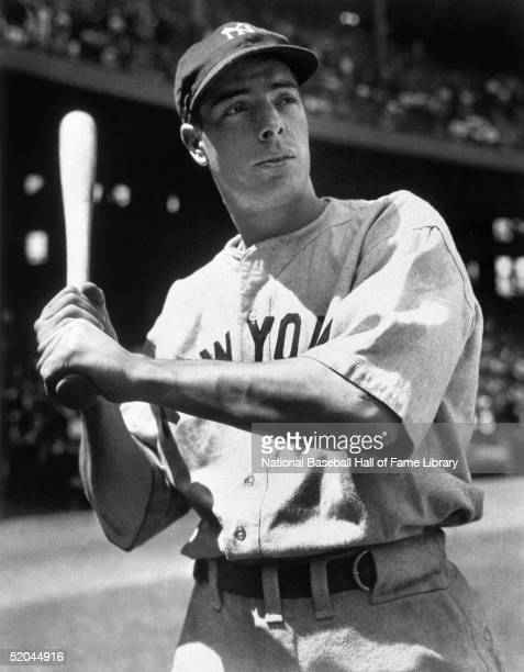 Joe Dimaggio poses for an action portrait. Joe Dimaggio played for the New York Yankees from 1936-1951.