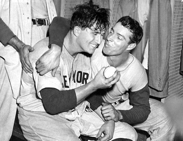 Joe DiMaggio rewards winning pitcher Frank Shea with a kiss