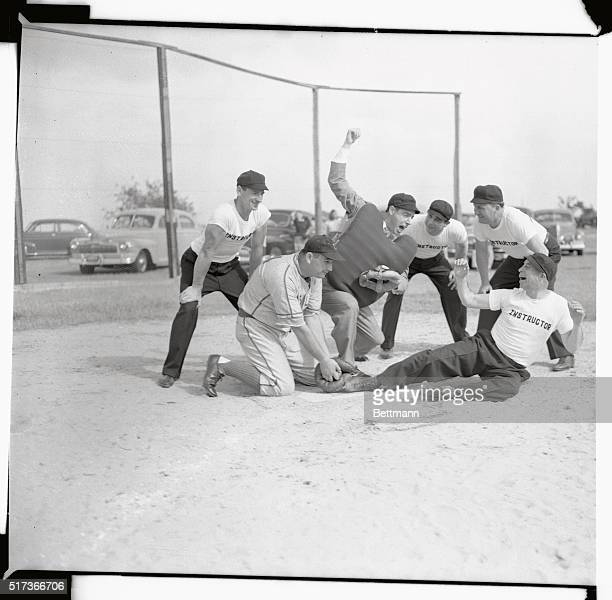 Joe DiMaggio veteran Yankee star and and one of baseball's highest salaried players visits Bill McGowan's Umpire School at West Palm Beach and gives...