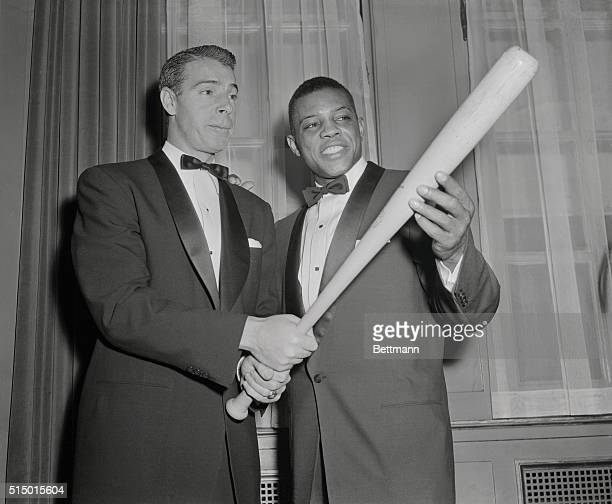 Joe DiMaggio, who was just voted to Baseball's Hall of Fame, passes on a few batting tips to Willie Mays, who's a slugger in his own right. Their...