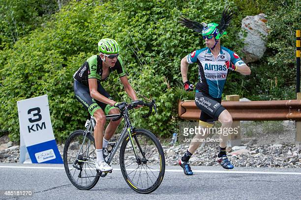 Joe Dombrowski of the CannondaleGarmin Pro Cycling Team gets cheered by a fan as he nears the finish of stage 6 of the Tour of Utah on August 8 2015...