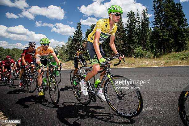Joe Dombrowski of the CannondaleGarmin Pro Cycling Team rides in yellow with teammate Ben King wearing the most aggressive rider jersey during stage...