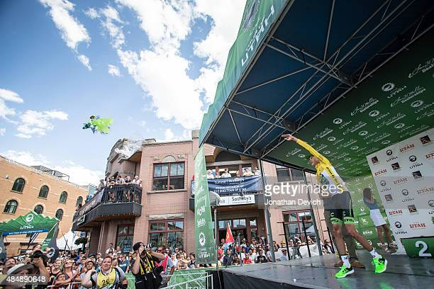 Joe Dombrowski of the CannondaleGarmin Pro Cycling Team throws his podium flowers to the crowd after stage 7 of the Tour of Utah on August 9 2015 in...