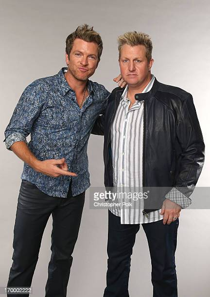Joe Don Rooney and Gary LeVox of Rascal Flatts pose at the Wonderwall portrait studio during the 2013 CMT Music Awards at Bridgestone Arena on June 5...