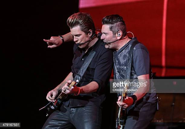 Joe Don Rooney and Jay DeMarcus of Rascal Flatts perform on stage on Day 2 of the C2C Music Festival at O2 Arena on March 16 2014 in London United...