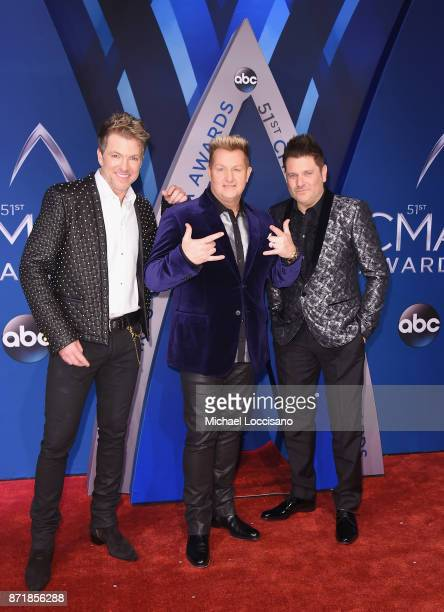 Joe Don Rooney Gary LeVox and Jay DeMarcus of Rascal Flatts attend the 51st annual CMA Awards at the Bridgestone Arena on November 8 2017 in...