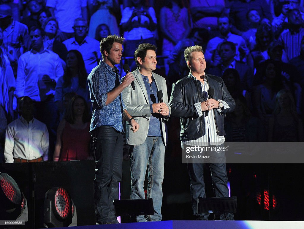 Joe Don Rooney, Gary LeVox and Jay DeMarcus of the band Rascall Flatts speak during the 2013 CMT Music awards at the Bridgestone Arena on June 5, 2013 in Nashville, Tennessee.
