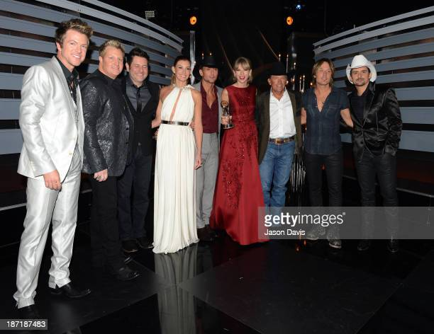 Joe Don Rooney Gary LeVox Jay DeMarcus Faith Hill Tim McGraw Taylor Swift George Strait Keith Urban and Brad Paisley pose backstage at the 47th...