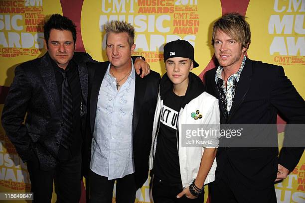 Joe Don Rooney, Gary LeVox, Justin Bieber and Jay DeMarcus of the Rascal Flatts attend the 2011 CMT Music Awards at the Bridgestone Arena on June 8,...