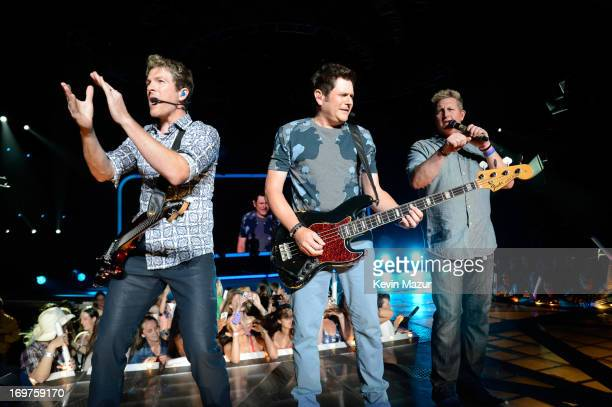 Joe Don Rooney Jay DeMarcus and Gary LeVox of Rascal Flatts perform at Nikon at Jones Beach Theater on May 31 2013 in Wantagh New York