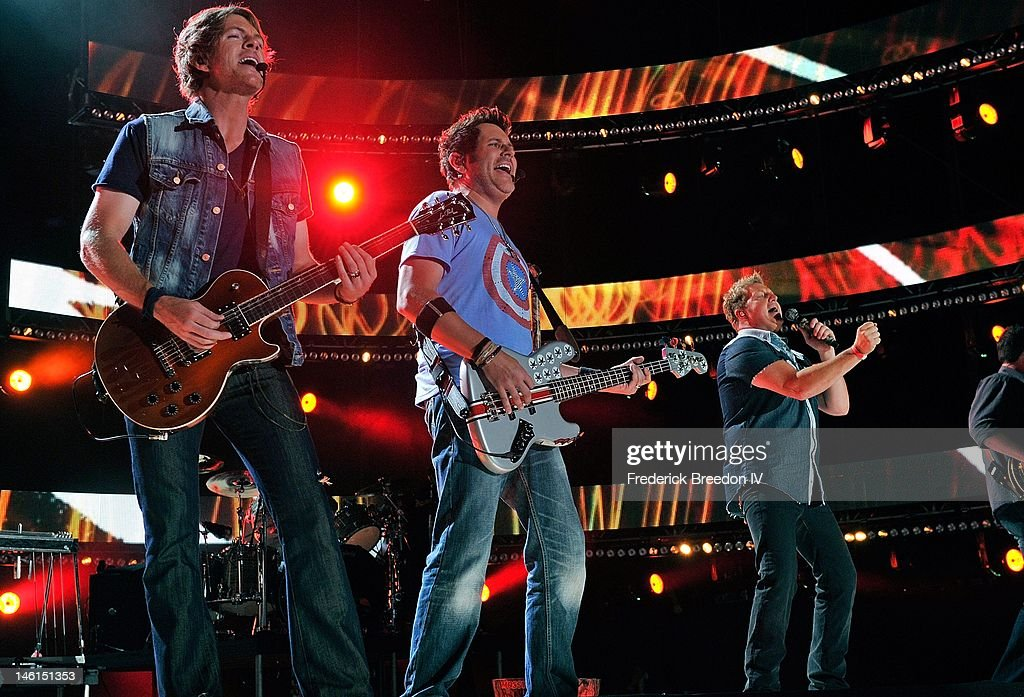 Joe Don Rooney, Jay DeMarcus, and Gary LeVox of Rascal Flatts performs at LP Field during the 2012 CMA Music Festival on June 10, 2012 in Nashville, Tennessee.