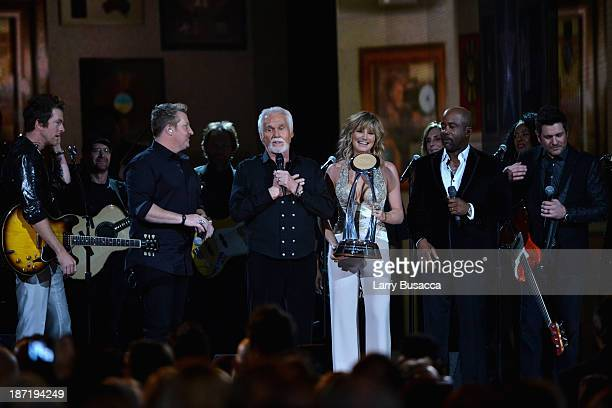 Joe Don Rooney, Jay DeMarcus, Willie Nelson Lifetime Achievement Award winner Kenny Rogers, Jennifer Nettles, Darius Rucker and Gary LeVox onstge...