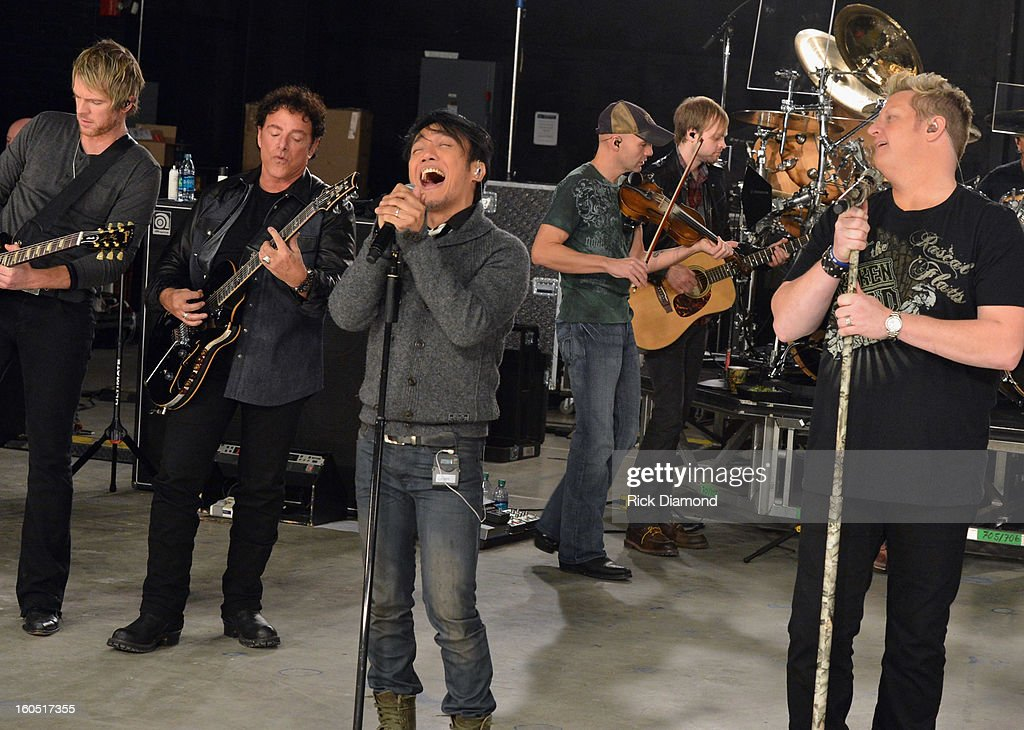 Joe Don Rooney, Neal Schon, Arnel Pineda and Gary LeVox perform during CMT Crossroads: Journey and Rascal Flatts Live from Super Bowl XLVII rehearsals on February 1, 2013 in New Orleans, Louisiana.